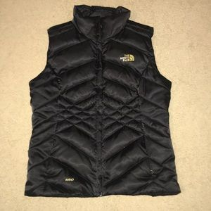 North face black and gold vest
